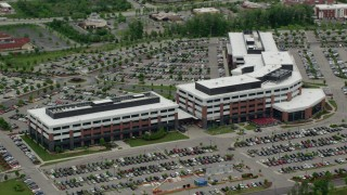 AX106_024 - 5K stock footage aerial video orbiting a modern office building, Cranberry Township, Pennsylvania