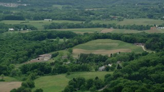 AX106_029 - 5K stock footage aerial video orbiting rural homes in Cranberry Township, Pennsylvania