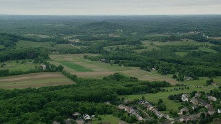 AX106_030 - 5K stock footage aerial video farmland in Zelienople, Pennsylvania