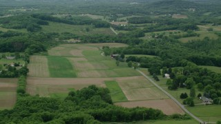 AX106_031 - 5K stock footage aerial video of farm fields in Zelienople, Pennsylvania