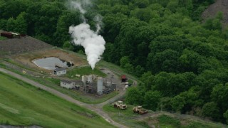 AX106_033 - 5K stock footage aerial video orbiting Recycling Center Furnace, Zelienople, Pennsylvania