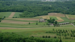 AX106_044 - 5K stock footage aerial video of a farmhouse and farmland in Beaver Falls, Pennsylvania