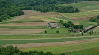 AX106_045 - 5K stock footage aerial video of a farmhouse and farmland in Beaver Falls, Pennsylvania