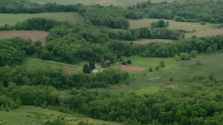 AX106_050 - 5K stock footage aerial video of barns and trees in Koppel, Pennsylvania