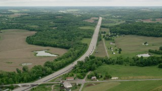 AX106_052 - 5K stock footage aerial video approaching Interstate 76 with light traffic in New Galilee, Pennsylvania