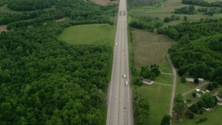 AX106_053 - 5K stock footage aerial video flying over Interstate 76 with Light Traffic in New Galilee, Pennsylvania