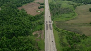 AX106_054 - 5K stock footage aerial video of light traffic on Interstate 76 in New Galilee, Pennsylvania