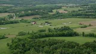 AX106_057 - 5K stock footage aerial video of red barns and farmhouses in Enon Valley, Pennsylvania