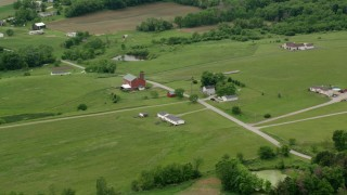 AX106_058 - 5K stock footage aerial video flying over rural homes and a red barn in Enon Valley, Pennsylvania