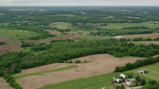 AX106_059 - 5K stock footage aerial video of farms and trees in Enon Valley, Pennsylvania