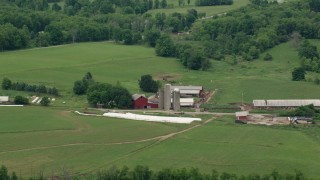 AX106_060 - 5K stock footage aerial video of a red barn and silos in Enon Valley, Pennsylvania