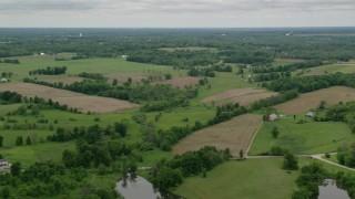 AX106_062 - 5K stock footage aerial video of farmland in Enon Valley, Pennsylvania