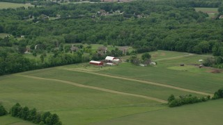 AX106_063 - 5K stock footage aerial video approaching red barns in Enon Valley, Pennsylvania