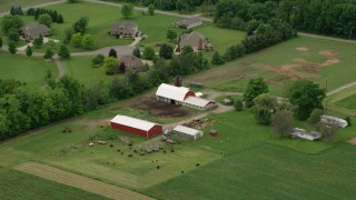 AX106_064 - 5K stock footage aerial video flying over red barns in Enon Valley, Pennsylvania