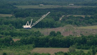 AX106_065 - 5K stock footage aerial video of a tall crane by a forest in Enon Valley, Pennsylvania