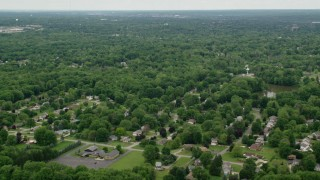 AX106_067 - 5K stock footage aerial video of suburban neighborhoods, Youngstown, Ohio