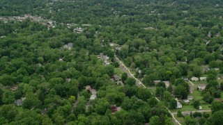 AX106_070 - 5K stock footage aerial video of suburban neighborhoods, Youngstown, Ohio