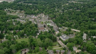 AX106_071 - 5K stock footage aerial video orbiting shops in small town, Youngstown, Ohio