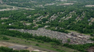 AX106_074 - 5K stock footage aerial video approaching an auto junkyard in Youngstown, Ohio