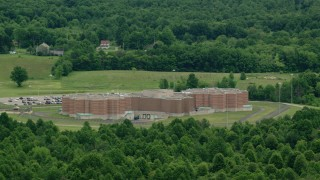 AX106_078 - 5K stock footage aerial video approaching Ohio State Penitentiary, Youngstown, Ohio