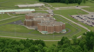 AX106_082 - 5K stock footage aerial video orbiting the side of the Ohio State Penitentiary, Youngstown, Ohio