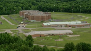 AX106_089 - 5K stock footage aerial video orbiting Ohio State Penitentiary, Youngstown, Ohio