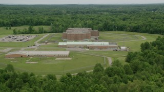 AX106_090 - 5K stock footage aerial video orbiting Ohio State Penitentiary, Youngstown, Ohio