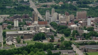 AX106_097 - 5K stock footage aerial video orbiting the campus of Youngstown State University, Ohio