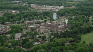 AX106_099 - 5K stock footage aerial video approaching a hospital complex, Youngstown, Ohio