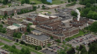 AX106_100 - 5K stock footage aerial video flying over a hospital complex, Youngstown, Ohio