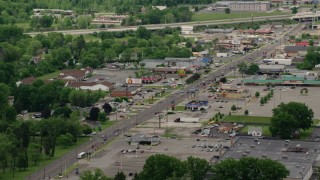 AX106_101 - 5K stock footage aerial video of a city street, shops and strip mall in Youngstown, Ohio