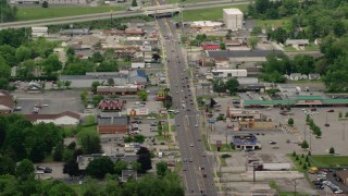 AX106_102 - 5K stock footage aerial video shops and strip mall by busy street in Youngstown, Ohio
