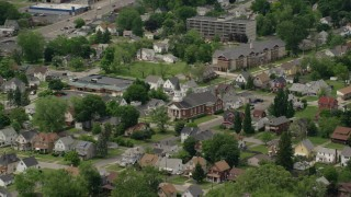 AX106_104 - 5K stock footage aerial video of church and homes in Youngstown, Ohio