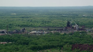 AX106_112 - 5K stock footage aerial video of a steel and mining factory in Warren, Ohio