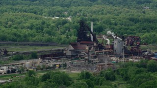 AX106_113 - 5K stock footage aerial video of a steel and mining factory in Warren, Ohio