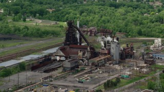 AX106_115 - 5K stock footage aerial video of a steel and mining factory in Warren, Ohio