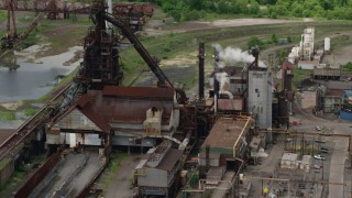 AX106_116 - 5K stock footage aerial video of a steel and mining factory in Warren, Ohio