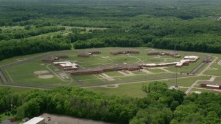 AX106_121 - 5K stock footage aerial video orbiting Trumbull Correctional Institute Prison in Leavittsburg, Ohio