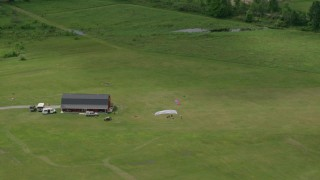 AX106_134 - 5K stock footage aerial video of skydivers on the Ground in Leavittsburg, Ohio