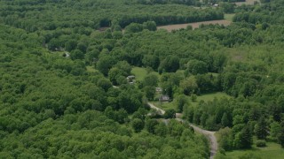 AX106_139 - 5K stock footage aerial video of a country road and rural homes in Windham, Ohio