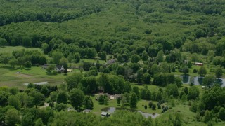 AX106_141 - 5K stock footage aerial video of farms and pond in Windham, Ohio