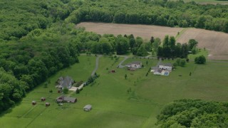 AX106_146 - 5K stock footage aerial video orbiting rural homes in Garrettsville, Ohio