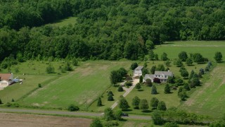 AX106_149 - 5K stock footage aerial video of a rural home in Hiram, Ohio