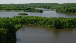 AX106_155 - 5K stock footage aerial video flying over a reservoir and small bridge in Akron City Reservoir, Chagrin Falls, Ohio