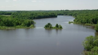 AX106_157 - 5K stock footage aerial video of a tiny Island with trees in Akron City Reservoir, Chagrin Falls