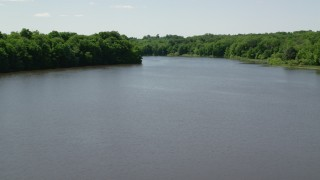 AX106_159 - 5K stock footage aerial video flying over Akron City Reservoir, Chagrin Falls, Ohio
