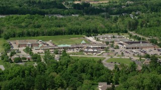 AX106_174 - 5K stock footage aerial video of a strip mall in Chagrin Falls, Ohio