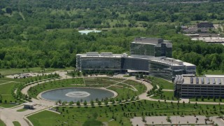 AX106_183 - 5K stock footage aerial video approaching a large modern office complex, Beachwood, Ohio