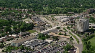 AX106_186 - 5K stock footage aerial video of strip malls on a city street in Cleveland, Ohio