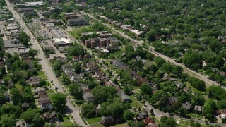 AX106_188 - 5K stock footage aerial video flying over apartment buildings and suburban homes in Cleveland, Ohio